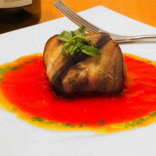 Parmigiana di melanzane con pesce spada